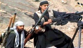 Shahab Dashti, left, in a 2009 militant propaganda video.